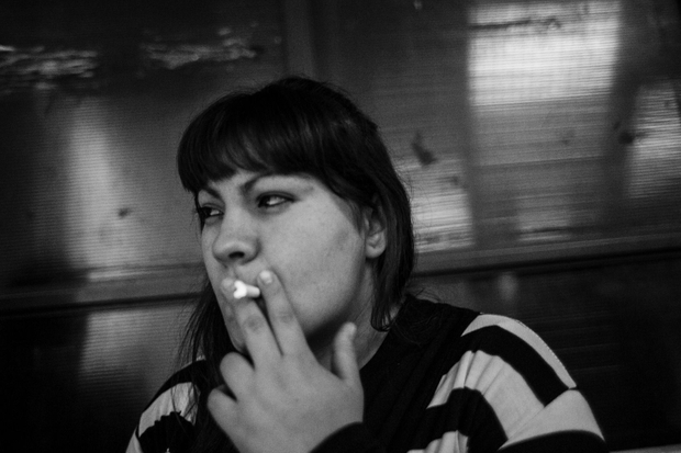 Dai smokes a cigarette before a trial. She was innocently accused of attempted murder while she was actually the victim. She spent three month in jail without her daughter before the trial even started where she was beaten up several times. The judges declared her innocent and the two sisters who accused her are to be judged because of false testimony.  © Sarah Pabst