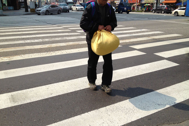 Man with a yellow parcel.