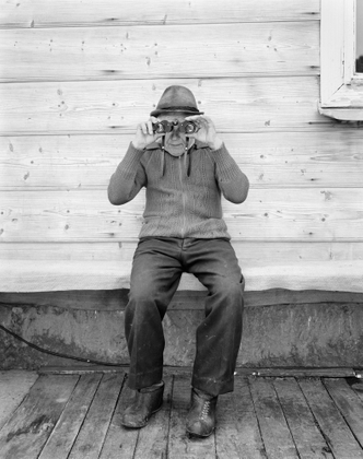Excerpted from the Series -- Portrait of a Village: The People of Kryvorivnya Ukraine (1992 – present), Vasyl Mychajlovich Potjak with binoculars, 1994