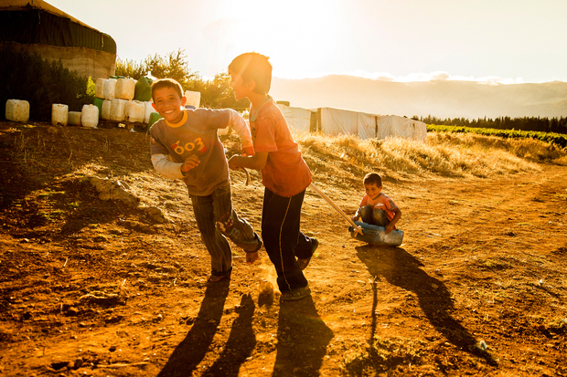 Boys playing with a setting sun, Syrian Border