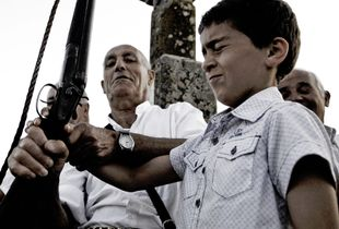 Introduction to life in Barbagia. A child shoots for the first time.