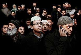 UK. London. 2010. Community members leave the East London Mosque after Eid prayers in London. Combined with the adjoining London Muslim Centre, it is one of the largest mosques in the United Kingdom. © Bharat Choudhary