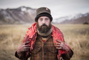 Josh carries buffalo back strap scavenged from a buffalo carcass. © Matt Hamon. Finalist, LensCulture Portrait Awards 2016
