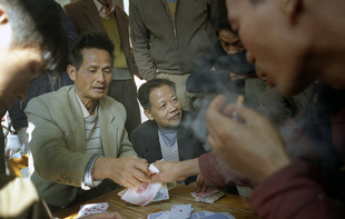 Men illegally gambling along side the roads - Guangdong province, China.