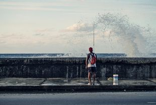 Streetlife of cuba series, fisherman on the malecón of havanna