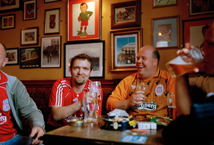 Liverpool football supporters from Norway enjoy a drink in a pub in Anfield, before the match with Charlton Athletic. Liverpool. 13 May 2007.