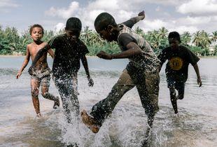 Kids playing soccer in Pangalanes waterway, Manakara, Madagacar, 2017.