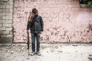 A male guerilla fighter of the YPS in Kurdish dominant city Nusaybin in southeast Turkey, near the Syrian border. Heavy gunfights took place during several curfews between Turkish government special forces and Kurdish YPS guerilla fighters.