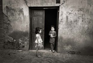 Two girls in a doorway, Mangal Bazar, Patan, Nepal