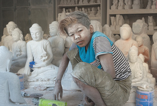 Dust covered child labourer at workshop in Mandalay, Myanmar.