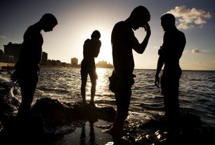 CUBA. A group of Cuban young men take a break from swimming in the water in front of the Malecon sea wall in Havana, Cuba. © Brian L Frank, US / Independent / Editorial Photojournalist / Brian is a POYI and NPPA award winner. http://www.brianfrankphoto.com.