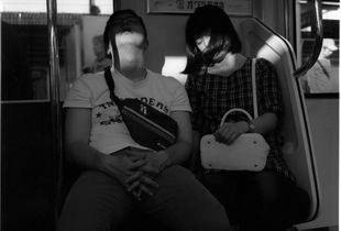 in the train/summer/a sleeping  couple