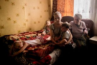 Svetlana with her three children and mother-in-law, living close to the frontline and fearful of night shelling.