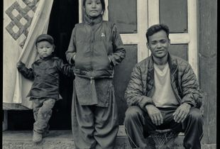 Everest porter Moti Magar at Lukla with 11year-old Kamita Tamang and toddler Sonam Sherpa