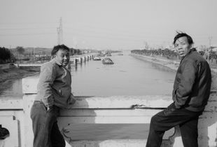 Couples. Photographing along the 113-km Huangpu River through the city of Shanghai, China.