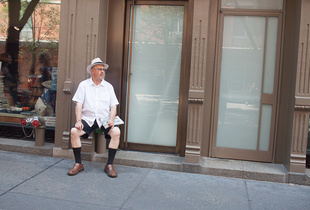 Man resting on street in NYC