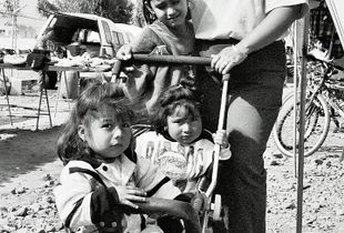 Mother and children at marcet in Tijuana, Mexico