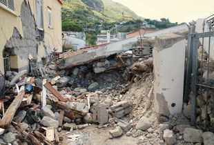 The totally collapsed house where Ciro and his two little brothers were rescued.