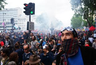 Looking at the incoming huge tear gas cloud at a protest against the Loi Travail (Labour Law) - Paris (France), 14/06/2016
