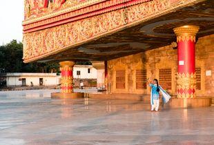 Girl takes a selfie during golden hour at the Global Vipassana Pagoda, Mumbai, India