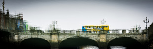 Dublin bus on bridge over the river