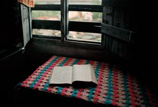 Sabita Poudel's Bible, Banshighat, one of fourteen squatter settlements along the Bagmati River, 2012
