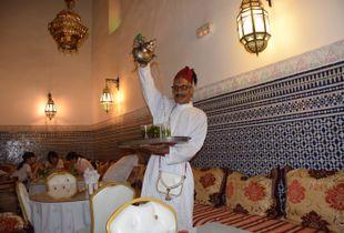 Man pouring tea Marrakesh