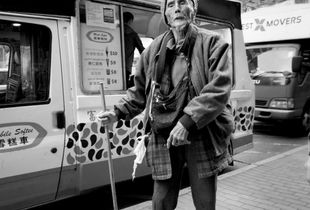 Blindness  in front of ice-cream car, Mong Kok, Hong Kong
