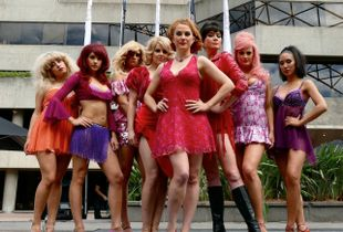 "Performers in the musical ""Sweet Charity"" pose for me outside the Arts Centre, Melbourne."