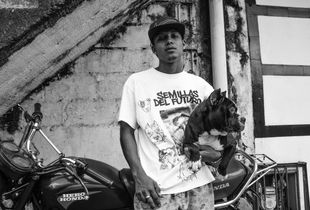 """Andrés, part of the rap collective """"Seeds of the Future"""" with his friend's bulldog."""