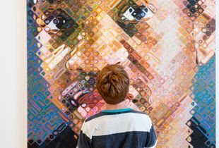 Tillman looking at Chuck Close's Lyle