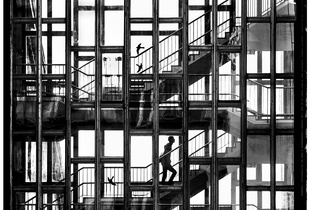 Cage. A student is walking upstairs in the staircase of Budapest University of Technology, Budapest, Hungary. © Zsolt Birtalan. Chosen for the LensCulture Street Photography Awards Top 100.
