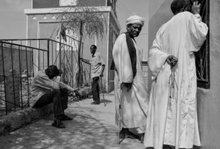 People gather around Hamid El-Nil tomb to listen to the mysterious music echoing from within. Khartoum. Sudan. 2017
