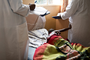 A 9 year old survivor of sexual violence in the post-operations ward of Panzi Hospital