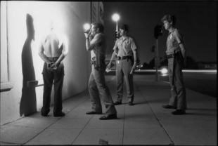 Police 01. Police photographing a prisoner on the street in San Diego, California.