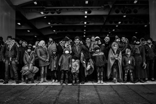 Refugees and migrants wait to disembarked from Eleftherios Venizelos ferry at the port of Piraeus, near Athens, Greece, on the 23rd of January 2016. Greek government has chartered Eleftherios Venizelos ferry to transfer refugees and migrants from the Greek islands to the Greek mainland.