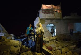 Safia Mohamed Al-Najar, 47, and her 25 year old son Fadi Al-Najar saw their home in Khan Yunis destroyed by airstrike during the 2014 summer's 50-day war. Despite the dangerous condition, they have to stay, since there is no place else for them to move, or too expensive to do so. And virtually no body has come to help them yet. The son was supposed to marry soon, but it was canceled.