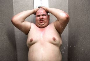 Fat Joe takes a shower after chain gang duty in Estrella Jail in Phoenix, Arizona.