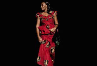 Elegant lady in wax cloth.