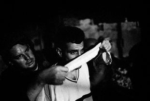 A Palestinian man is arrested and blindfolded during an Israeli army operation near Jenin, Palestine 2002 © Paolo Pellegrin
