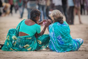 Women chatting on the beach - Mumbai, India.