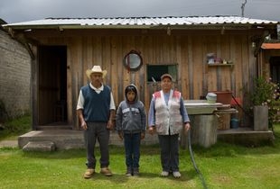 Jesus with his grandparents Pedro and Edgar in front of their house at Llano Grande , Oaxaca/ Mexico