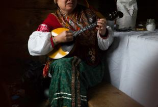 A vibrant Dombra player at the Fort Ross Annual Harvest Festival.