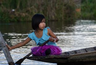 Burmese girl on river boat