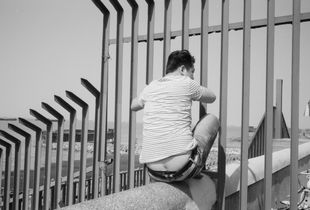 Fence And Wall. Photographing along the 113-km Huangpu River through the city of Shanghai, China.