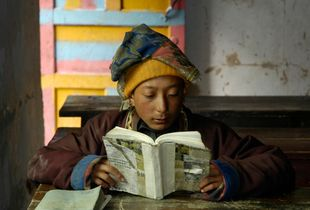 Nomad boy reading, Ponru School, Kham, Sichuan. China. 2005.