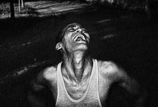 An addict laughs in the rehabilitation center.© Gazi Nafis Ahmed