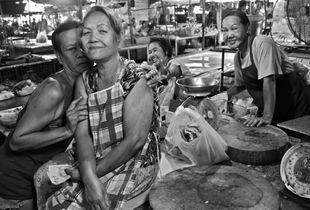 Market vendor family, Thailand