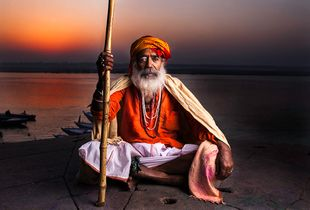 Gateway to heaven.  Sadhu greets Mother Ganges at sunrise in Varanasi, India.