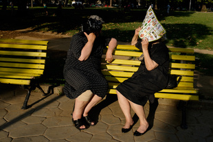 Tirana. Elderly women sitting on a bench in a park. © Alexandru Ilea. Chosen for the LensCulture Street Photography Awards Top 100.